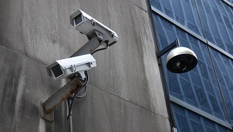 Surveillance empowers conformity