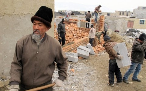 Uighurs work at a site to the west of Urumqi where houses are being built on the side of a hill with no water or electricity, and on a road on the way to a garbage dump. None of the people in this image were quoted in McClatchy's story. Perhaps more than any other corner of China, the city is now a showcase of the police state tactics used in tandem with economic growth by the country's rulers to maintain their vision of