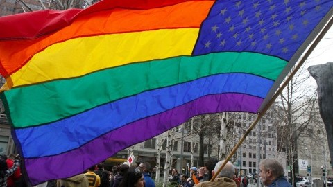 A gay-marriage supporter flies a rainbow flag during a rally in Seattle, Washington. (Greg Gilbert/Seattle Times/MCT)