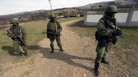 Russian troops stand guard blocking Ukraines military base at the town of Perevalnoye near Simferopol, in Crimea, on Thursday, March 6, 2014. (Sergei L. Loiko/Los Angeles Times/MCT)