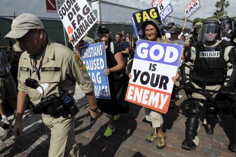 Police escort Westboro Baptist protesters away from another group of protesters on the second day of the Republican National Convention in Tampa, Florida, Tuesday, August 28, 2012. (Tiffany Tompkins-Condie/Bradenton Herald/MCT)