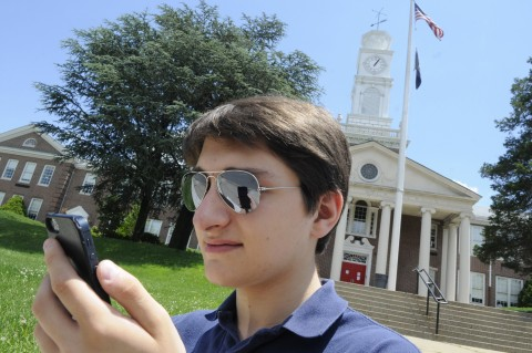 Michael Zhadanovsky, an incoming senior at Fort Lee High School, demonstrates how he sometimes uses the app, Uber, on his mobile phone, to get a ride home from school. (Carmine Galasso/The Record/MCT)
