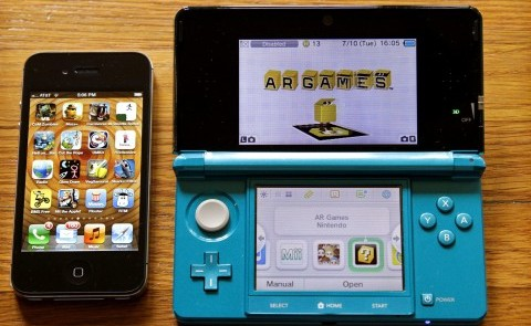 An iPhone is displayed at left beside a Nintendo 3DS, July 10, 2012. Nintendo's 3DS handheld game console is enjoying a sales revival after a disappointing launch in 2011. (Ricardo DeAratanha/Los Angeles Times/MCT)