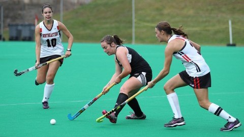 Sophmore Cliodhna Loughlin weaves the ball through two defenders during Sundays 2-1 loss to Northeastern. (Cade Belisle/Daily Collegian)