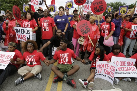 Brian Stepney, 20, center, joins about 300 other fast-food workers in blocking 87th Street at the Dan Ryan Expressway in Chicago on Thursday Sept. 4, 2014, as part of a country-wide protest in their push for a $15 hourly wage. Stepney, who has worked at McDonalds for about a year, was arrested with about a dozen protesters who refused to move from the street. (Michael Tercha/Chicago Tribune/MCT)