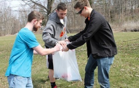 Sunday street cleanup promotes relationship between fraternities and Amherst