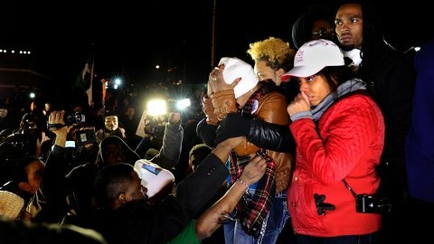 Lesley McSpadden, the mother of Michael Brown, clutching her head, reacts as she listens to the announcement Monday. Her son, an unarmed black teenager, was shot dead Aug. 9 by Darren Wilson, a white police officer.  (MCT)