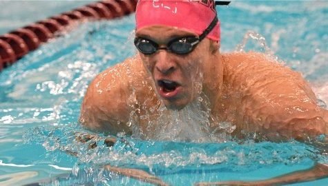 Michael Glenn serves as role model for UMass swimming and diving