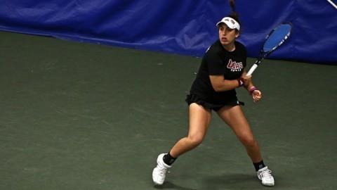 Ana Yrazusta prepares to hit the ball (Robert Rigo/Daily Collegian)