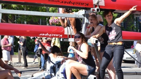 (The UMass Rowing team during the Homecoming Parade. Bryn Rothschild-Shea/Daily Collegian)