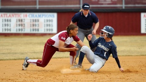 Quianna Diaz-Patterson tags her George Washington opponent at second base. (Cade Belisle/Daily Collegian)
