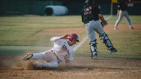 John Jennings slides into home plate. (Judith Gibson-Okunieff/Daily Collegian)