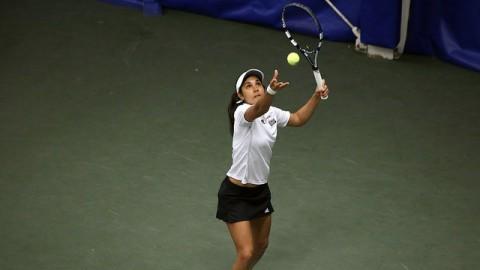 Carol Benito prepares to serve the ball. (Robert Rigo/Daily Collegian)
