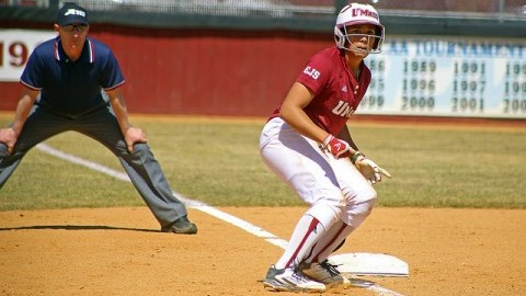 Quianna Diaz-Patterson waits for the batter to hit the ball on third base. (Robert Rigo/Daily Collegian)