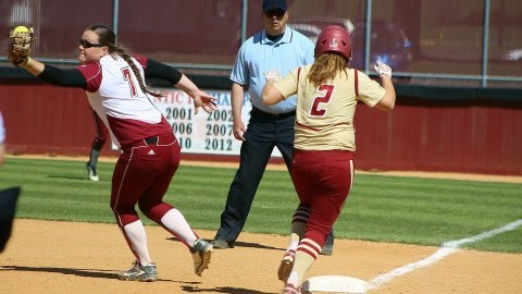 Bridget Lemire catches a tossed ball but fails to get her Boston College opponent out. (Robert Rigo/Daily Collegian)