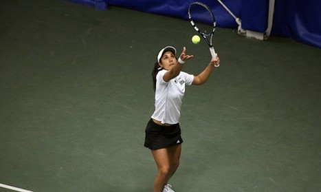 Carol Benito prepares to hit the ball. Robert Rigo/Daily Collegian