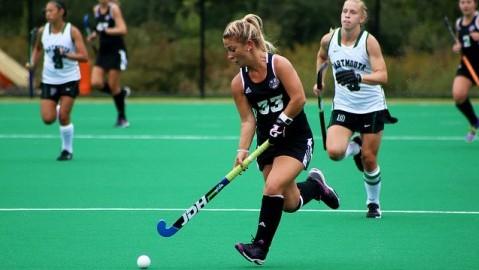 Nicole Miller carries the ball into the Dartmouth defensive zone on Sunday.  Robert Rigo/Collegian)