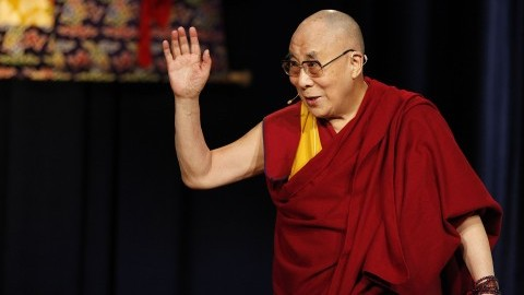 The Dalai Lama waves as he leaves the stage in Princeton, New Jersey in October 2014. His Holiness cancelled his visit next month to the University of Massachusetts. (Michael S. Wirtz/Philadelphia Inquirer/MCT)