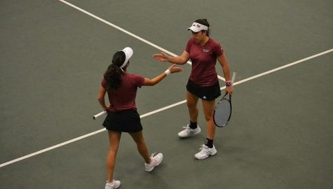 Ana Yrazusta and Carol Benito exchange high-fives during their match against the Army Women's Tennis team. Alex Lindsay/Daily Collegian