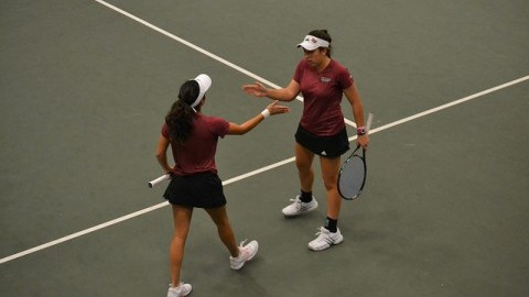 Ana Yrazusta and Carol Benito exchange high-fives during their match against the Army Womens Tennis team. Alex Lindsay/Daily Collegian