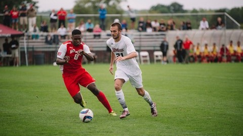 Kevin Boino dribbles past a BU player. Judith Gibson-Okunieff/ Daily Collegian