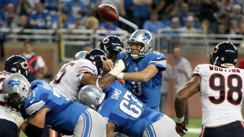 Detroit Lions' Matthew Stafford fumbles the ball, but recovers it for a touchdown during second-quarter action against the Chicago Bears at Ford Field in Detroit, Michigan, on Sunday, September 29, 2013. (Kirthmon F. Dozier Detroit/Free Press/MCT)