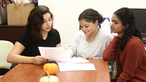 (Hannah Youssef (left), Kaylee Cortes (center), and Hema Ramachandran (right), all WOCLN staff members, plan out future events. Serena McMahon/ Daily Collegian)