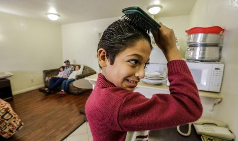 Eleven-year-old Omran Wawieh, right, a refugee from Syria, is staying with parents and siblings at a motel in Pomona, Calif., on Tuesday, Nov. 17, 2015. (Irfan Khan/Los Angeles Times/TNS)
