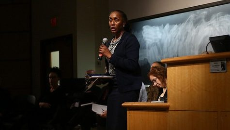 A. Yemisi Jimoh chair of the Faculty Senate Rules Committee speaks at a forum held on Dec. 3 in Mahar Auditorium. Robert Rigo/Daily Collegian