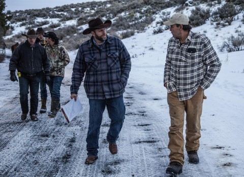 (Protest leader Ammon Bundy, holding papers, and others walk up from the Malheur National Wildlife Refuge headquarters compound on Thursday, Jan. 7, 2016, to speak to news reporters about their armed occupation. Steve Ringman/Seattle Times/TNS)