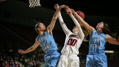 (Maggie Mulligan battles against two URI players for a rebound. Shannon Broderick/ Daily Collegian)