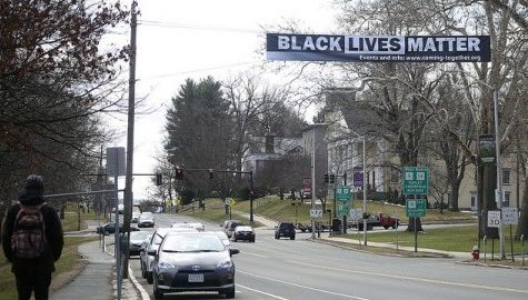 Community, police gather to unveil Black Lives Matter banner