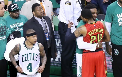 The Atlanta Hawks' Kent Bazemore (24) embraces the Boston Celtics' Jae Crowder while Isaiah Thomas (4) looks on as time expires with the Hawks eliminating the Celtics, 104-92, in Game 6 of the Eastern Conference quarterfinals at TD Garden in Boston on Thursday, April 28, 2016. (Curtis Compton/Atlanta Journal-Constitution/TNS)