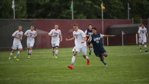 Alex Desantis running with the ball in the game against UNH on Tuesday September 6, 2016. Photo by Judith Gibson-Okunieff