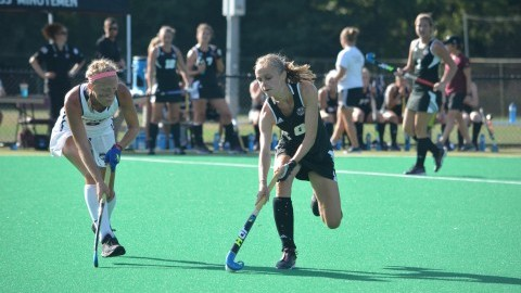 Anne Dijkstra (8) dribbles the ball at the game against UConn on Friday.