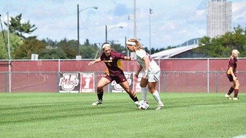 Erin Doster evades CMU player during Sunday's game at Rudd Field. (Katherine Mayo/Daily Collegian)