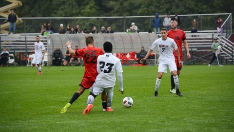 Samuel Asamoah passes the ball to Alex Desantis vs Dayton on Saturday. (Alex Tang/Daily Collegian)