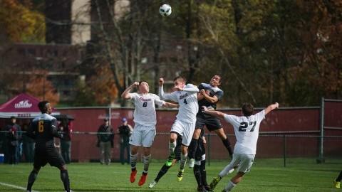 Konrad Gorich (4) and Josh Jess (6) jump into the air to head the ball. (Judith Gibson-Okunieff/Daily Collegian)