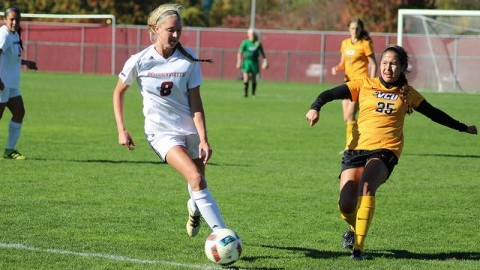 Megan Burke dribbles the ball during Sunday's game against VCU Rams at Rudd Field. Jong Man Kim/Daily Collegian)