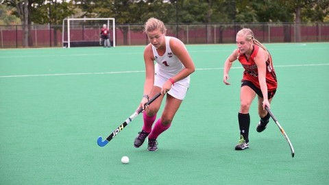 Hannah Farrell sweeps the ball from her opponent in a game against SFU at Gladchuck Field. Photo by Katherine Mayo/Daily Collegian)