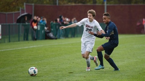 Stephen Ravazzoli (20) and a George Washington player fight for the ball. Judith Gibson-Okunieff/Daily Collegian)