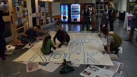 Students make a sign supporting Standing Rock outside the craft center in the Student Union on Nov. 3. Sam Anderson/Daily Collegian)