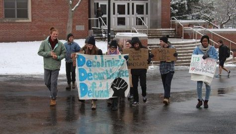 Amherst residents rally against Dakota pipeline in water ceremony outside TD Bank
