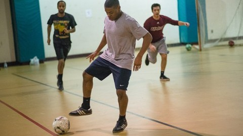 Ahanna Ugorji, sophomore electrical and computer engineering major, plays pick up soccer in Boyden gym on Sunday Nov. 27. (Judith Gibson-Okunieff/Daily Collegian)