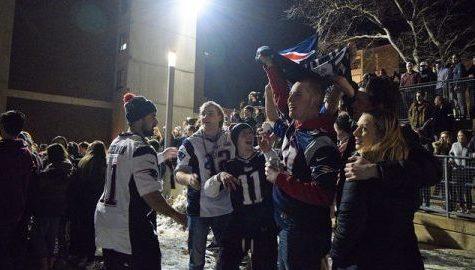 Students celebrate the Patriots winning the Super Bowl in Southwest Sunday night. Katherine Mayo)