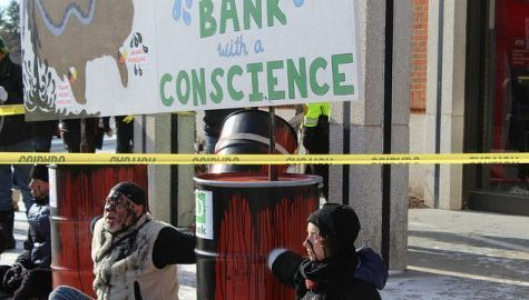Non-violent direct action in Amherst Center against big banks' pipeline funding