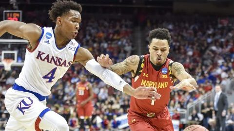 Kansas guard Devonte' Graham (4) chases after a loose ball with Maryland guard Jaylen Brantley (1) in the first half during a Sweet 16 matchup in the NCAA Tournament's South region at the KFC Yum! Center in Louisville, Ky., on Thursday, March 24, 2016. (Rich Sugg/Kansas City Star/TNS)