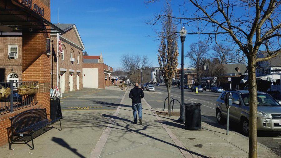 Ken+Johnston+walks+on+North+Pleasant+Street+through+downtown+Amherst+on+Feb.+17%2C+2018.+%28Henry+Brechter%2FDaily+Collegian%29