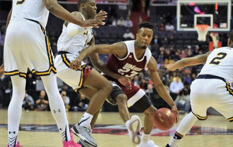 UMass men's basketball escapes with opening round win over La Salle