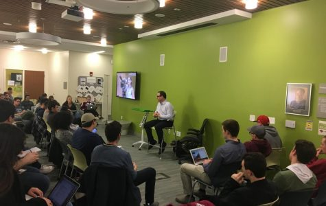 ESPN's Adrian Wojnarowski speaks with UMass students, faculty